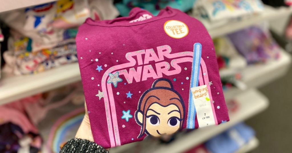 Star Wars themed girls graphic tee in pink color folded in hand