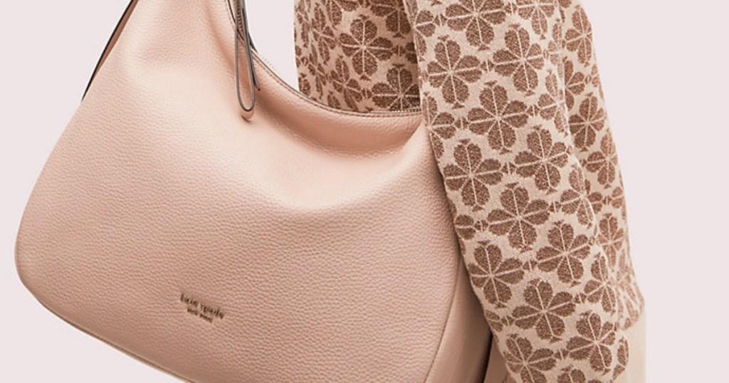 woman carrying Kate Spade Large Hobo Handbag