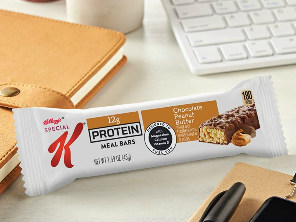 Kellogg's Protein bars next to a computer and a diary