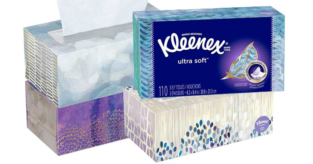 four boxes of facial tissue stacked by each other