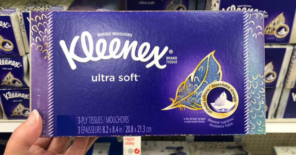 box of kleenex being held by a woman