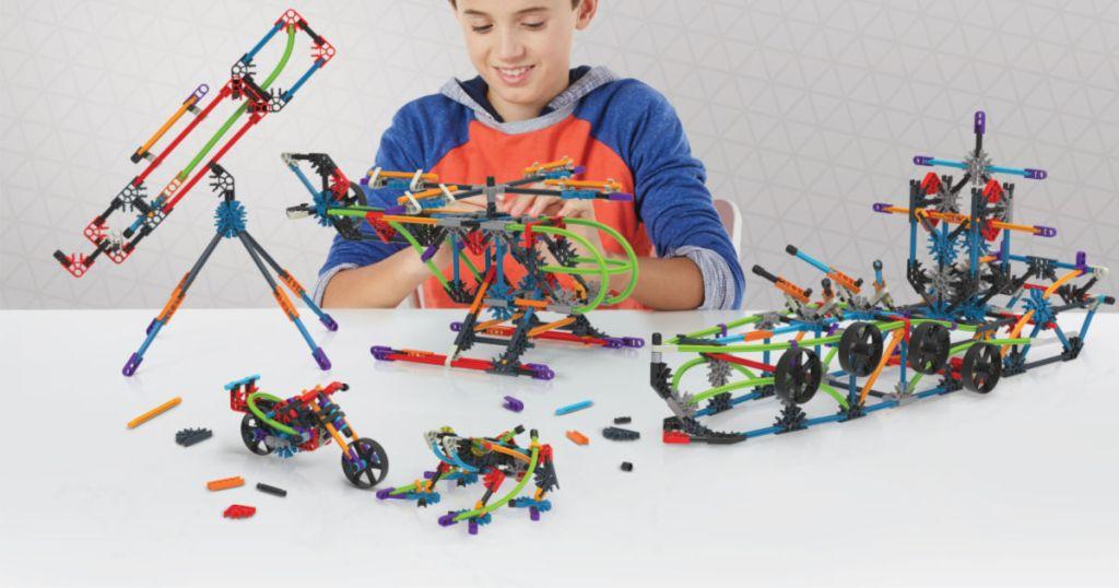boy playing with K'nex Intermediate 60 Model Building Set