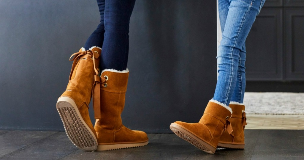 woman and girl wearing brown suede UGG boots and jeans