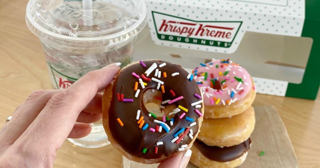 hand holding Krispy Kreme mini doughnut