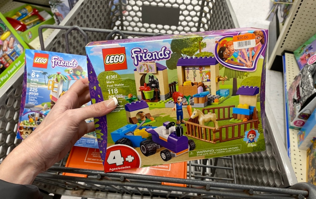hand holding LEGO Friends Mia's Foal Stable in BIg Lots cart
