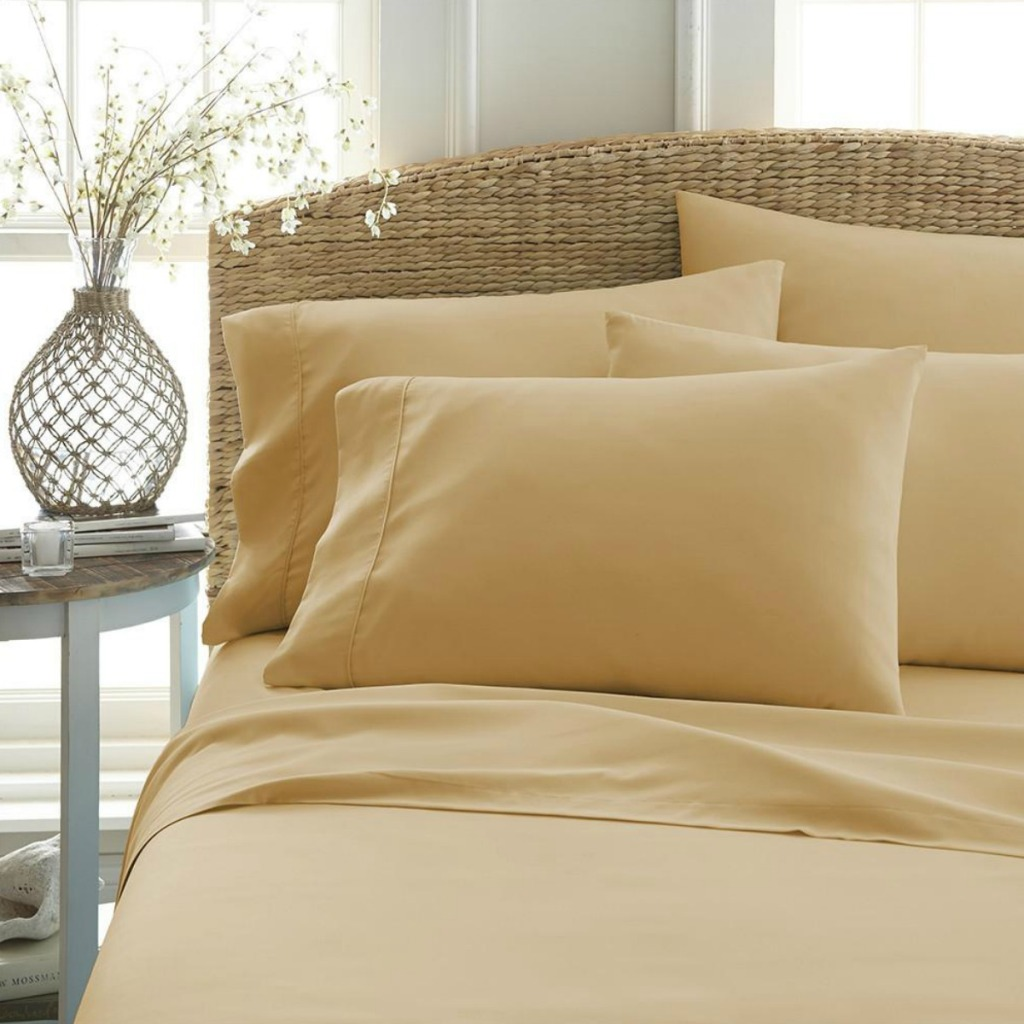 Golden sheets on matching bed in bedroom