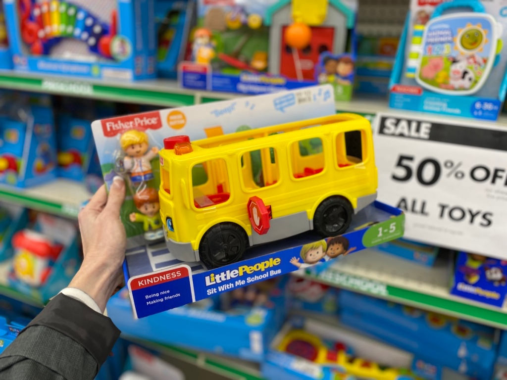 hand holding Little People Fisher-Price Bus