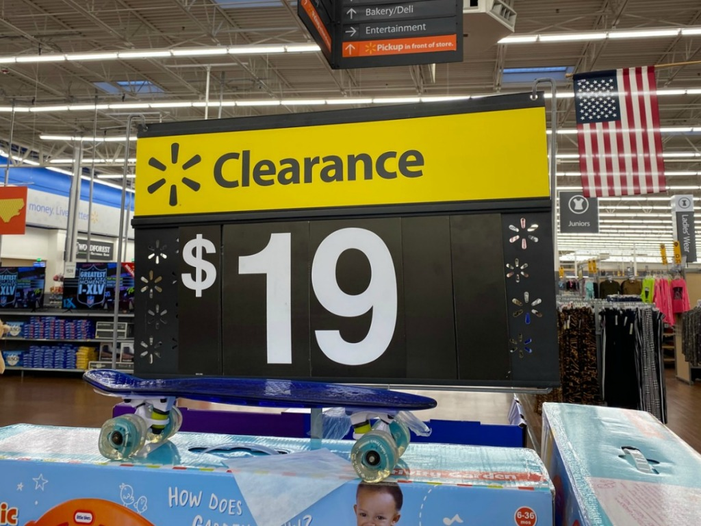 Walmart clearance sign for 19 dollars above a garden themed toy box