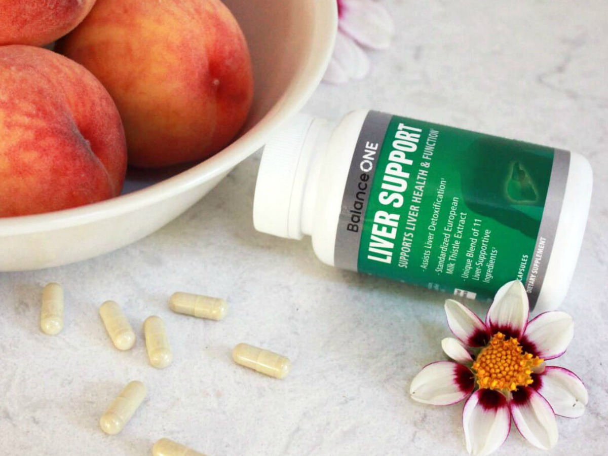 balanceONE liver support near a bowl of peaches