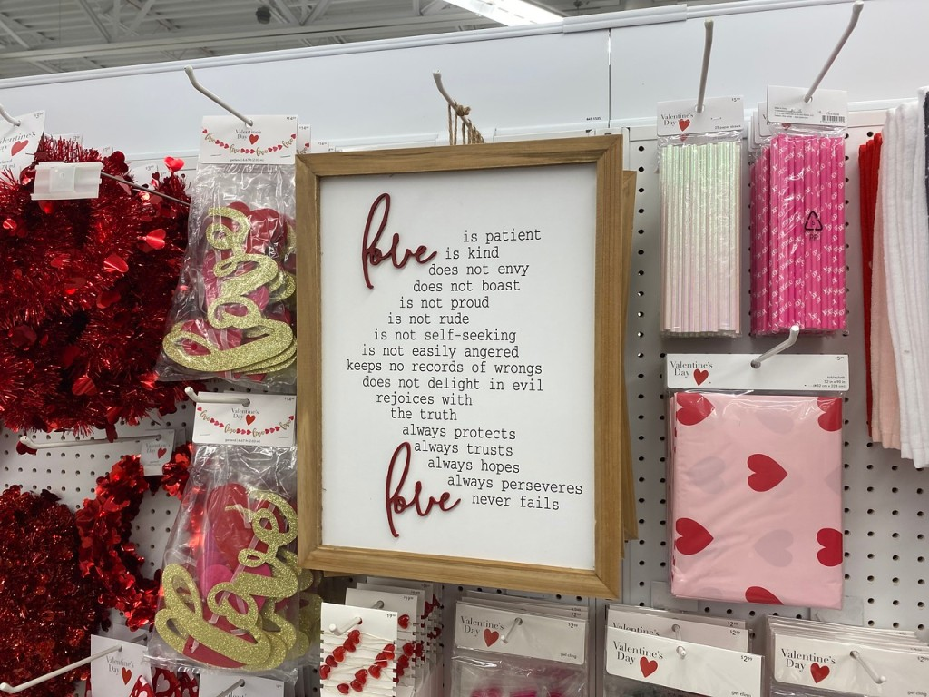Love is Patient Sign hanging on Joann's pegs
