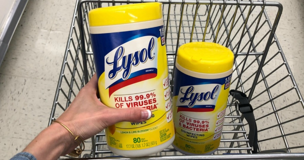 woman holding a canister of Lysol wipes