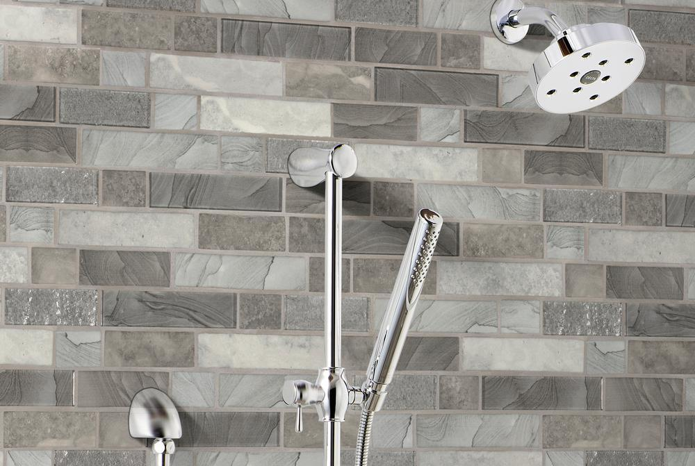 showerhead with tile behind it