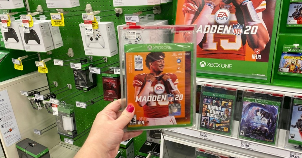 hand holding madden 20 video game in store