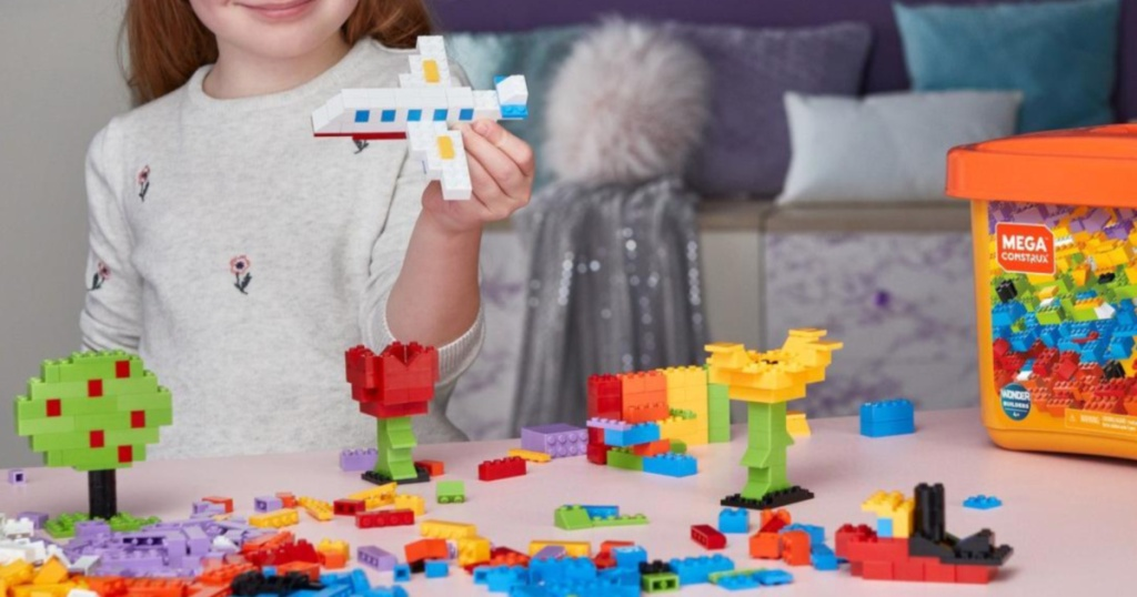 Little girl playing with Mega Construx Building Blocks