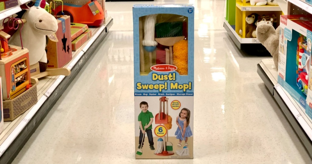 Melissa & Doug brand toy set with pretend duster, broom, and mop in package in store aisle