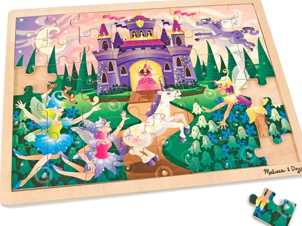 melissa & doug puzzle with picture of castle and unicorns and faries
