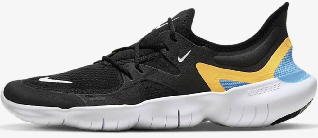 Men's black and white athletic shoe with yellow and light blue detailing