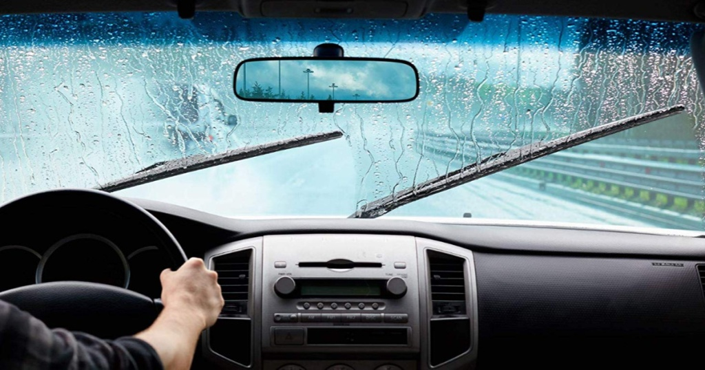 view of wiper blades being used during rain from inside of car