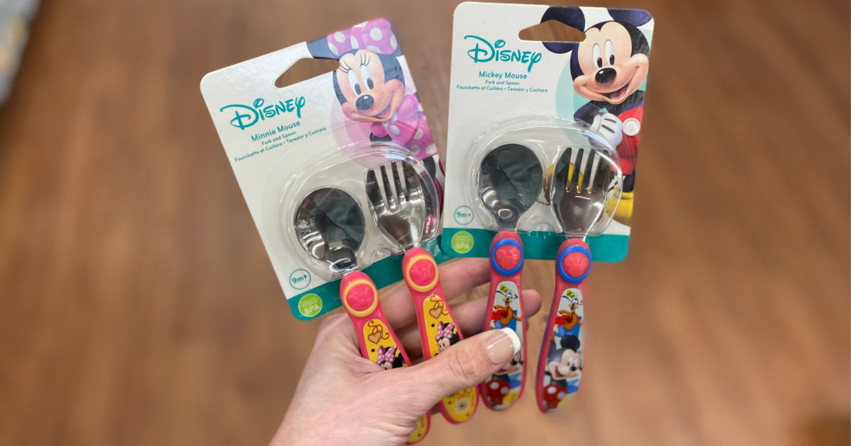 hand holding Mickey Mouse and Goofy Silver Ware for Kids