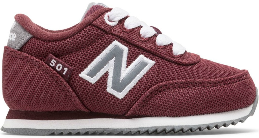One burgundy colored infant sized shoe with gray N and white laces