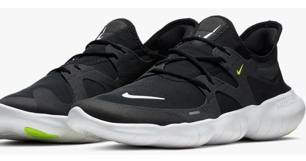 two black Nike shoes