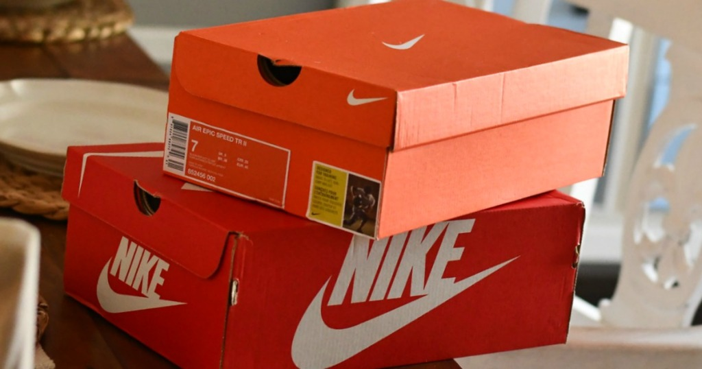 Stack of NIKE shoe boxes at dining room table