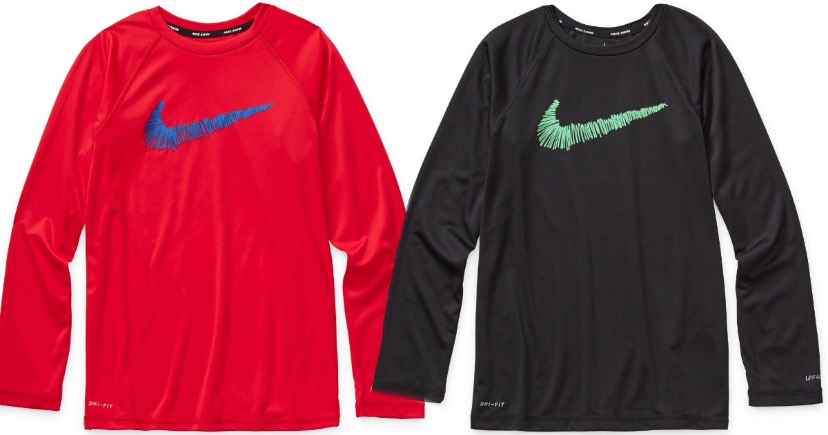 Nike boys Swim Shirts in red and black stock images