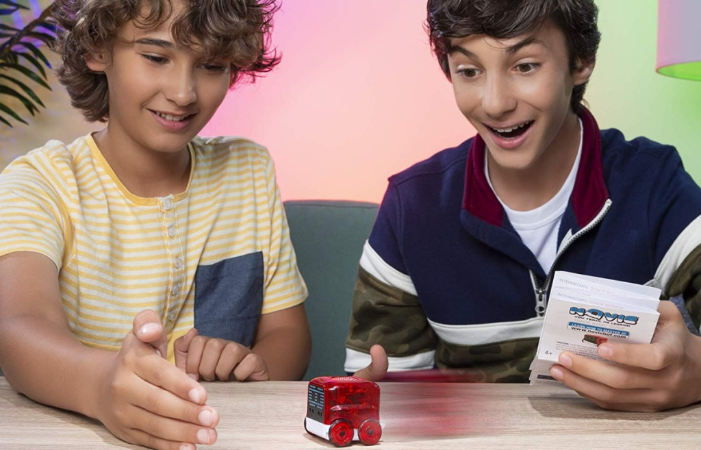 two boys playing with Novie Interactive Smart Robot Red