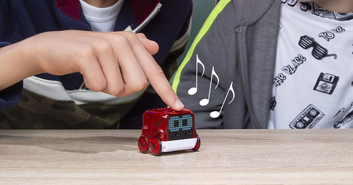 kids playing with Novie Interactive Smart Robot in red