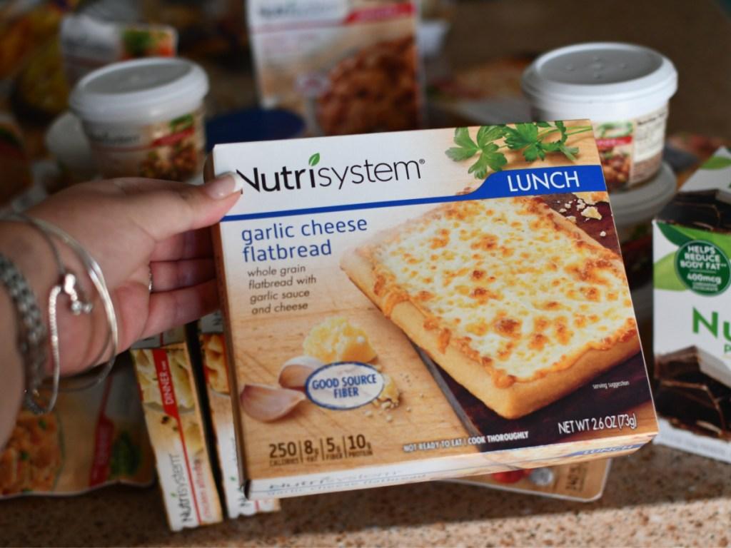 hand holding nutrisystem garlic cheese flatbread pizza
