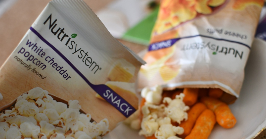 Nutrisystem popcorn and cheese puffs pouring out onto plate