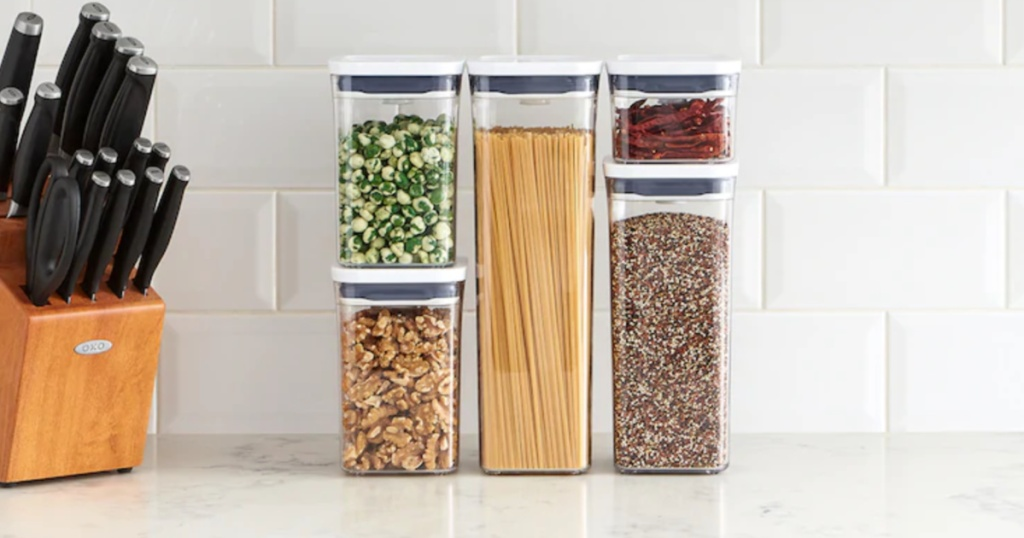OXO Pop 5-Piece Food Storage Container Set with pasta, nuts, grains, and more inside