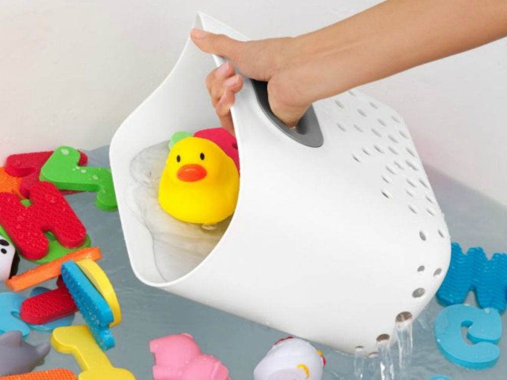 Mom using toy bin scoop to clean up bath toys