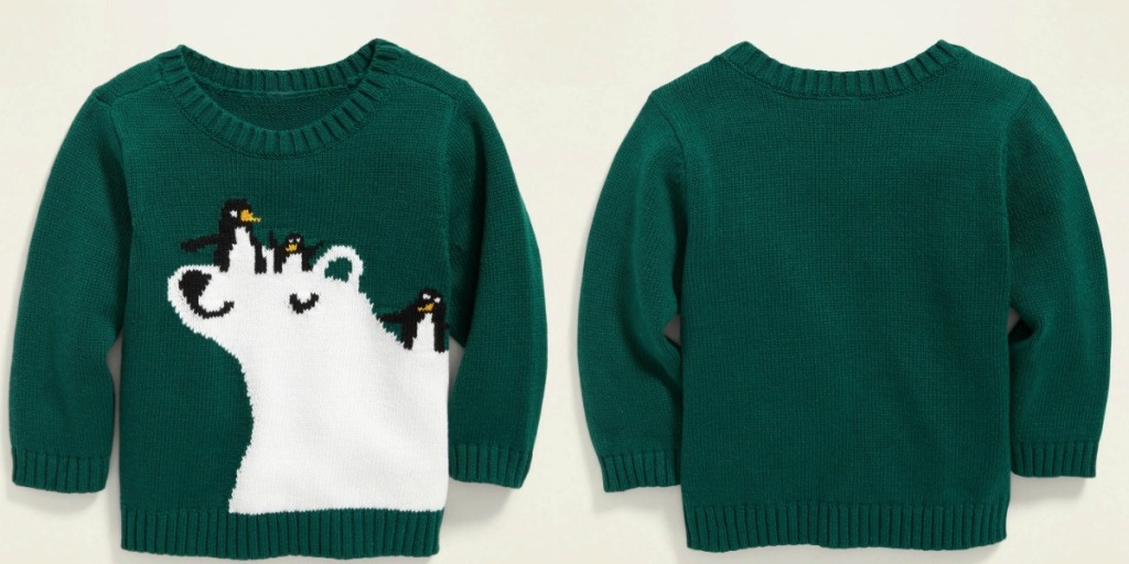 Front and back view of a green baby sweater with a polar bear on the front