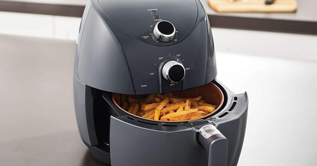 Oster Air Fryer on counter top with fries inside basket