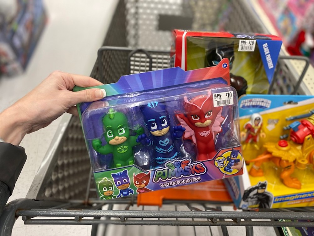 hand holding PJ Masks Bath Squirters by Big Lots cart