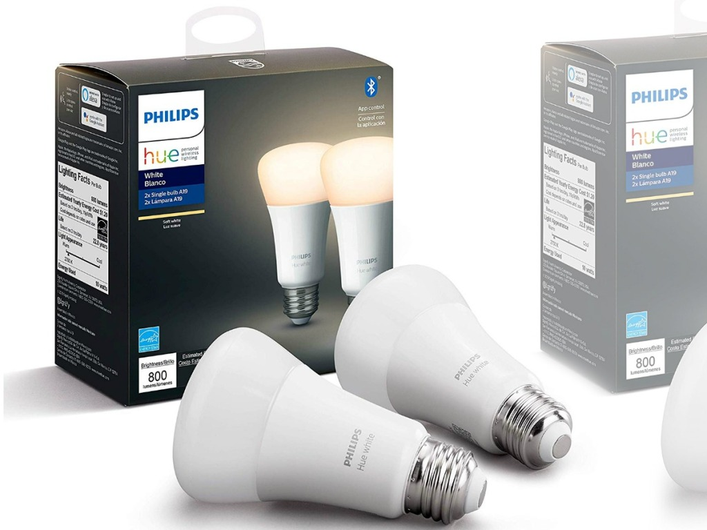 Two pack of smart lightbulbs on white table top with packaging