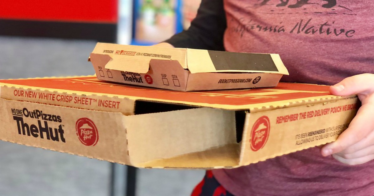 boy carrying Pizza hut boxes