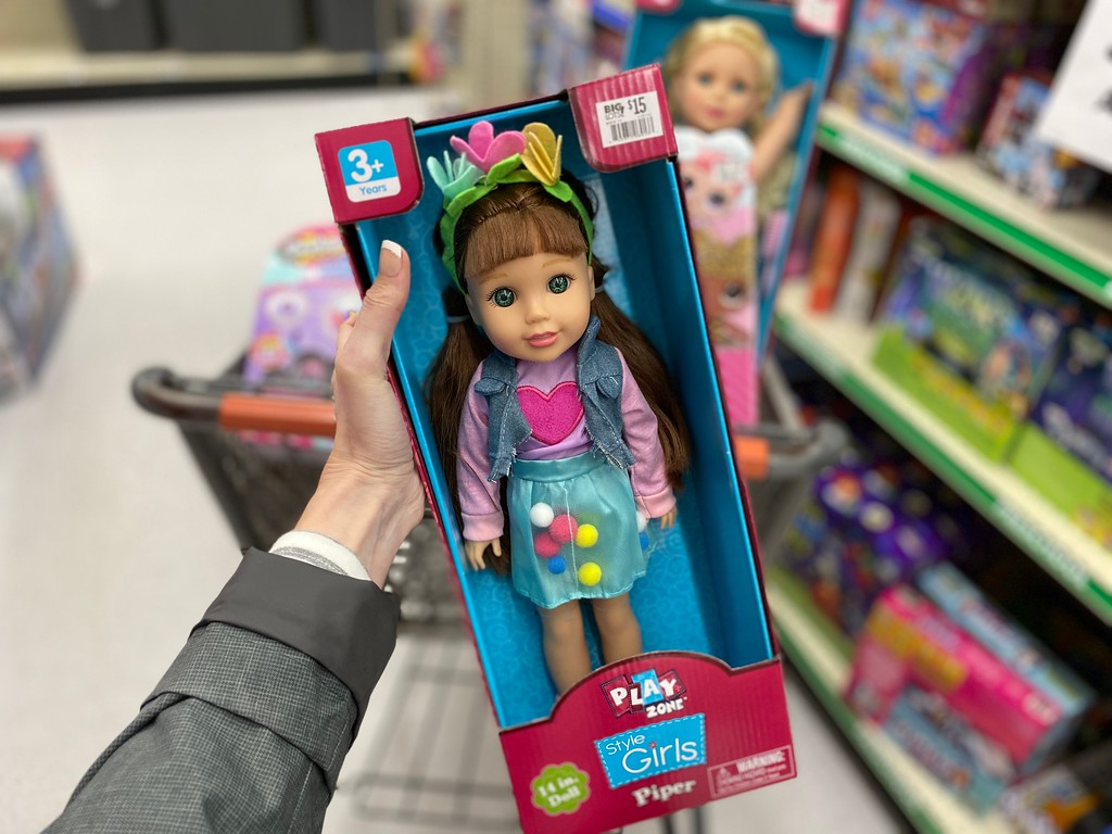 hand holding Play Zone Doll at Big Lots