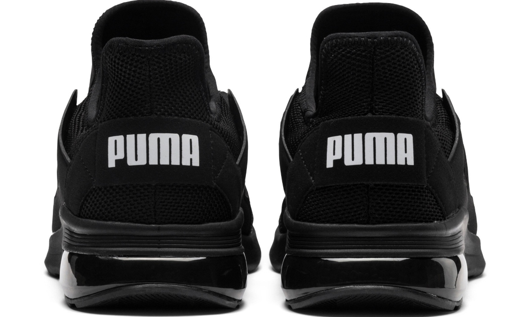 Back view of Black Puma Sneakers, with white lettering