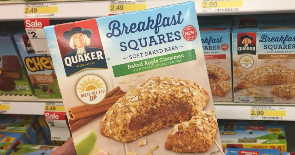 Quaker Breakfast Squares in box in hand near in-store display