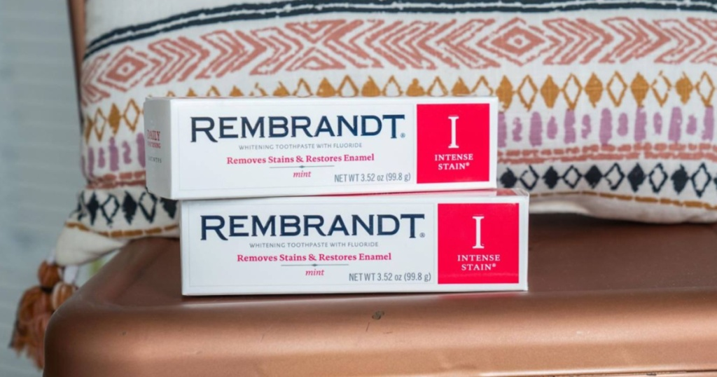 Rembrandt Toothpaste sitting on a stool in front of a pillow