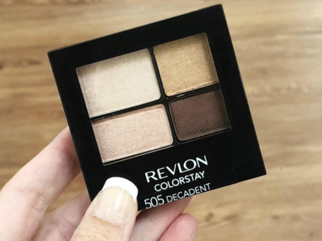 hand holding a Revlon eyeshadow