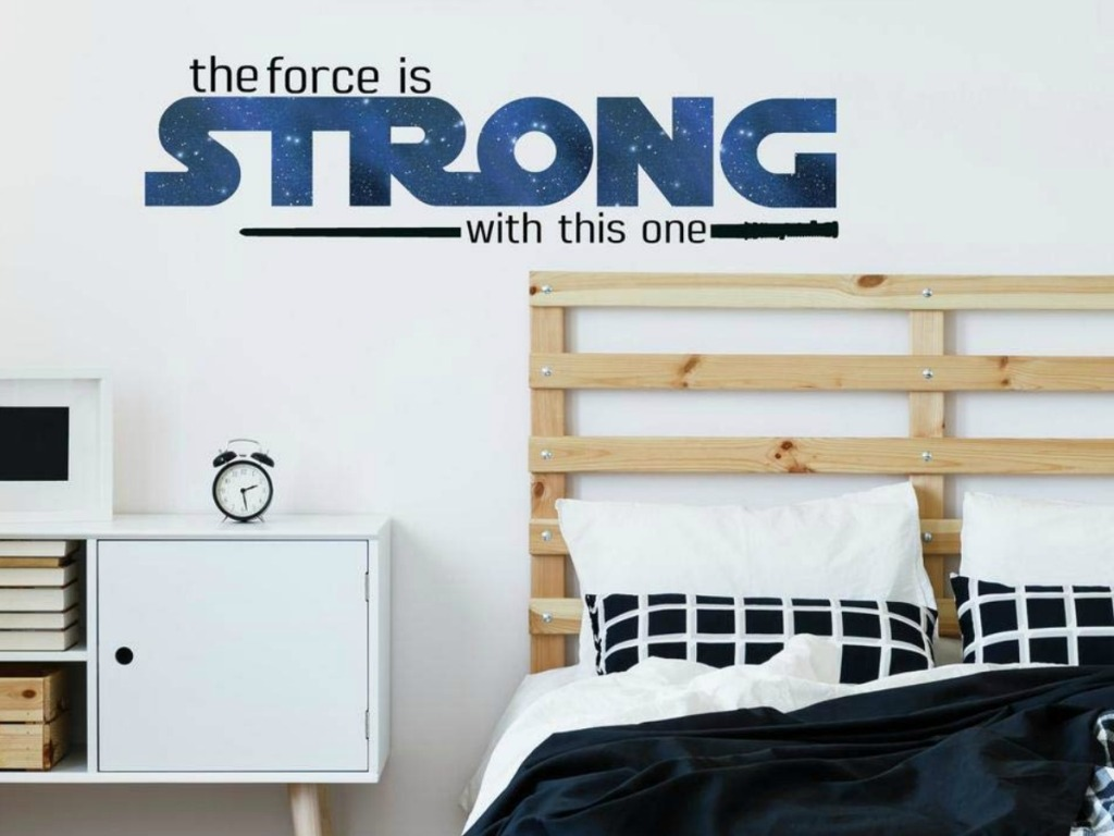 Star Wars themed wall decal near bed in bedroom