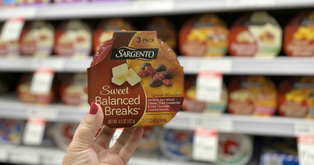 woman holding up Sargento Sweet Balanced Breaks in-store