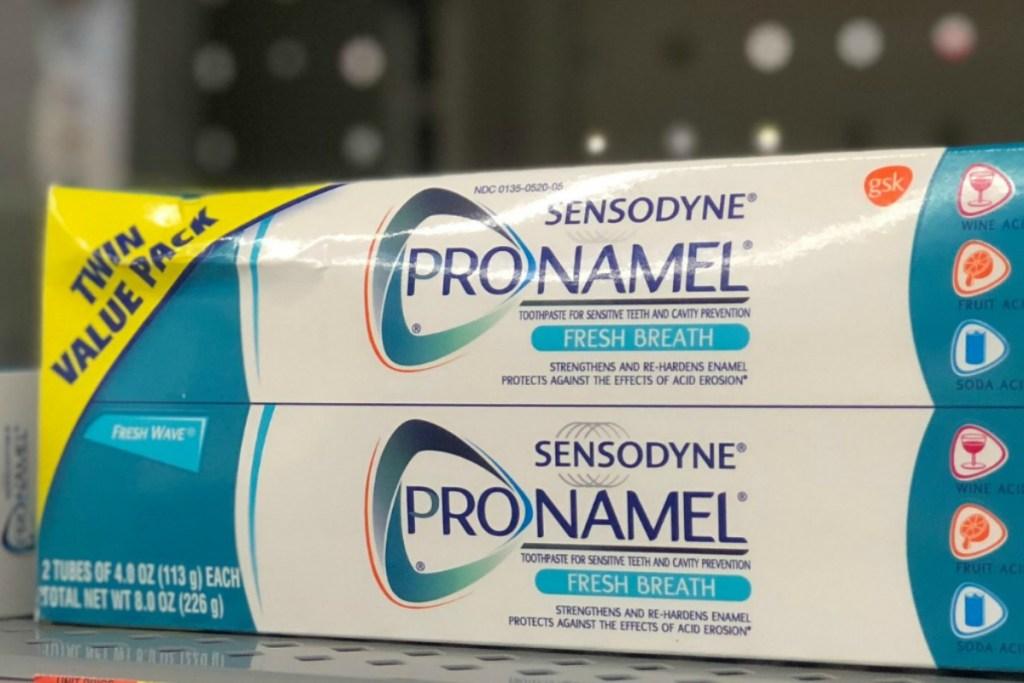 Sensodyne brand toothpaste on shelf in-store on display
