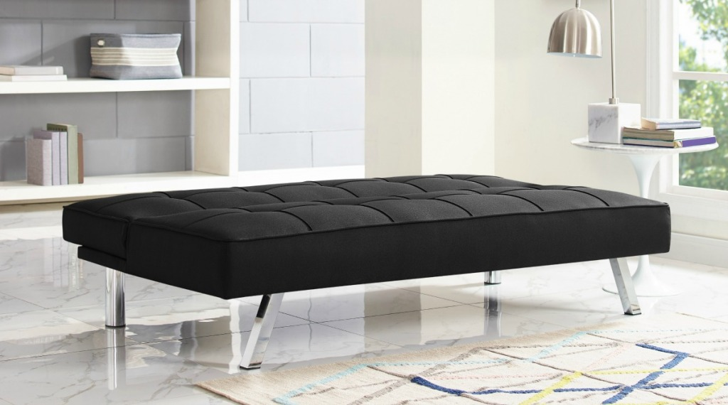 black sofa converted into a bed base