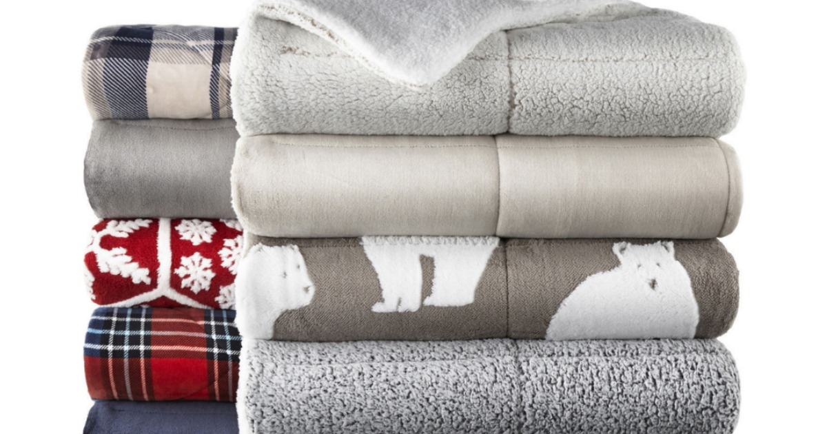 stacks of sherpa throw blankets stock image