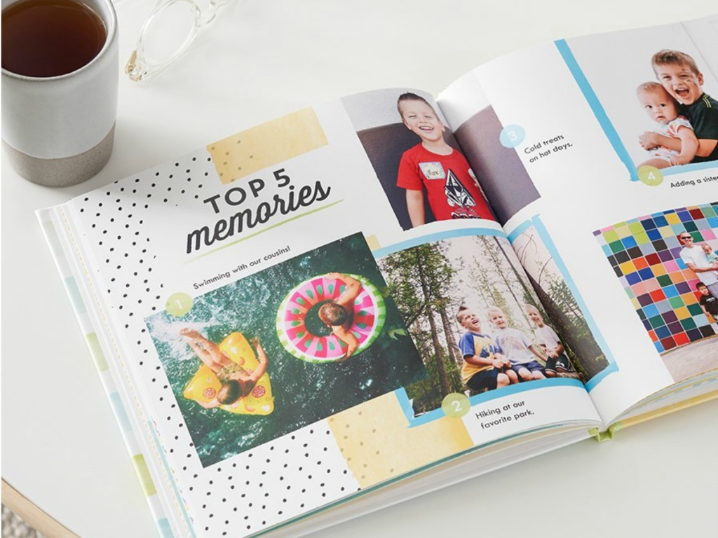 Shutterfly Photo Book open on table next to cup of coffee