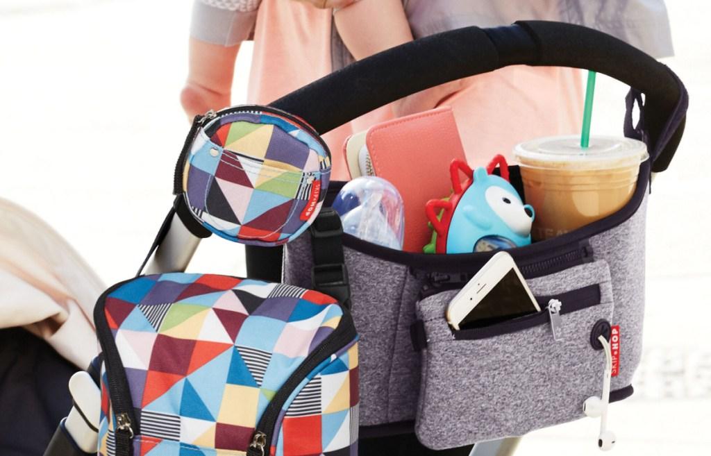 Skip Hop Pacifier Pocket hooked on stroller